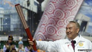 Nursultan Nazarbayev with the Olympic torch at Kazakhstan's Medeo speed skating stadium near Astana, Kazakhstan in 2008