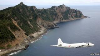 File photo: A Japan Maritime Self-Defence Force surveillance plane flies around the disputed islands in the East China Sea, 13 October 2011