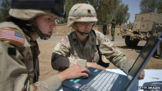 US soldiers using a laptop