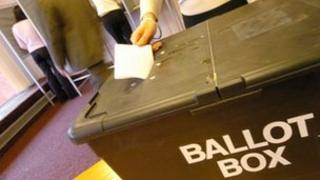 Voter casting ballot in election