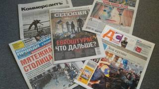 Ukrainian newspapers showing headlines about protests in Kiev