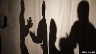 Shadows of people talking