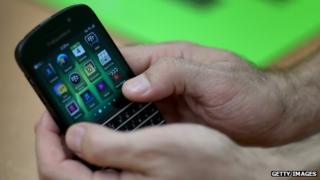 BlackBerry phone in hands