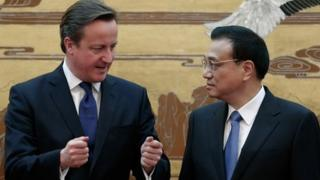 British Prime Minister David Cameron (L) talks with Chinese Premier Li Keqiang (R) during the signing ceremony at the Great Hall of the People on December 2, 2013 in Beijing, China.