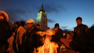 Protesters warm by a fire in Kiev