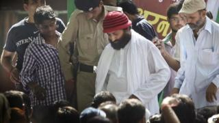 Asaram Bapu's son Narayan Sai, centre in red cap, attends a rally in support of his father in Delhi, on Tuesday, Sept 3, 2013