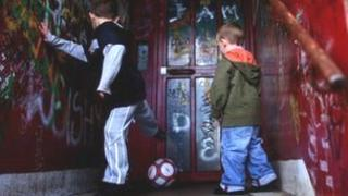 Boys play football in doorway