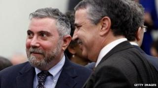 New York Times columnists Paul Krugman and Tom Friedman at a White House forum on December 3, 2009.