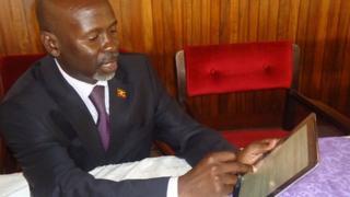 Ugandan MP Elijah Okupa with his iPad