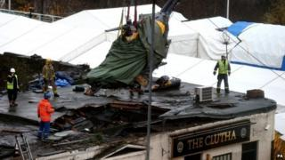 Helicopter being removed from The Clutha