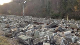Part of the sea defences lie on rail line at Mostyn, Flintshire