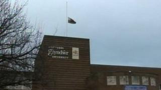 Glyndwr university flag at half mast
