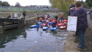 A group of kayakers move into Dudbridge Upper Lock, Stroud