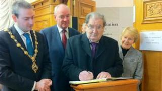 Former SDLP leader John Hume was among those who signed the book of condolence in Londonderry