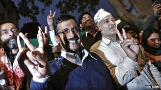 Arvind Kejriwal (C), leader of the Aam Aadmi Party, at his party office in Delhi