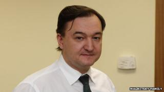 Magnitsky, in a family photograph - looking at camera