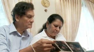 Sarath Peiris and Sudharma Narangoda looking at photo album