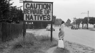 A sign common in Johannesburg, South Africa, reading 'Caution Beware Of Natives' (1956)