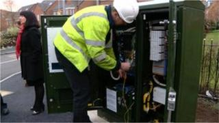 BT switches on fibre optic broadband at a street cabinet in Leeds