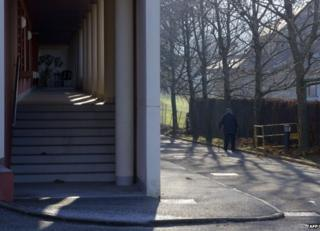 A man walks outside the home in Jacob-Bellecombette, Chambery, 12 December