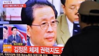 A South Korean watches television coverage of the execution of Chang Song-Thaek.