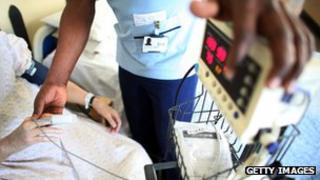 Nurse taking temperature