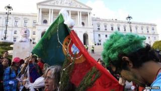 Anti-austerity protesters outside the Portuguese parliament in Lisbon