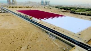 Giant Qatari flag outside Doha