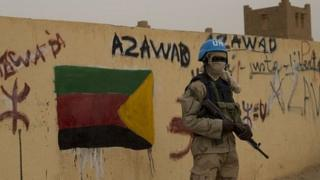 UN peacekeeper guards polling station in Kidal. 14 Dec 2013