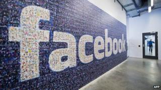 Facebook logo created using photos