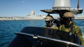 Norwegian marines patrol waters around HNOMS Helge in Cyprus on 14 December 2013