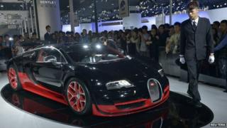 A Bugatti Veyron on show at the Guangzhou International Automobile Exhibition in Guangzhou, Guangdong province, November 22, 2013.