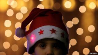 Boy wears santa hat