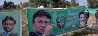 Banners showing images of former Pakistani military ruler Pervez Musharraf near his residence in Islamabad (November 2013)