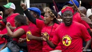 Members of the National Union of Metalworkers of South Africa (NUMSA) march through the Durban central business district, September 12, 2013.