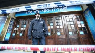 Police cordon off the Apollo Theatre in Shaftesbury Avenue, central London as investigators are trying to establish the cause of the ceiling collapse that injured 80 people, seven seriously