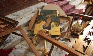 Icons and overturned furniture on the ground at the church of Saint Michael in the Syrian village of Qara, November 2013