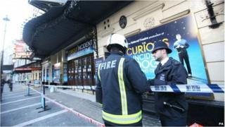 Firefighter and police officer outside the Apollo Theatre