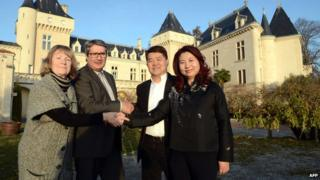 James Gregoire and Lam Kok with their wives outside the Chateau de la Riviere on 20 December 2013