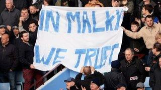 Cardiff fans hold up a flag