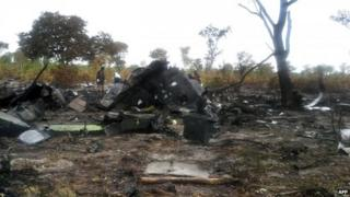 """the burnt wreckage of a Mozambican Airlines plane at the site of its crash in Namibia""""s Bwabwata National Park"""