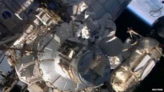 Astronauts repairing the International space Station