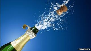 champagne cork shooting out of bottle