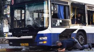 Israeli police inspect the bomb-damaged bus in Bat Yam (22 December 2013)