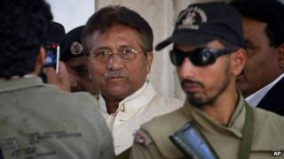 In this Wednesday, April 17, 2013 file photo, Pakistan's former president and military ruler Pervez Musharraf, centre, leaves after appearing in court in Rawalpindi, Pakistan.