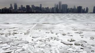 Snow-covered Lake Michigan with Chicago in the background. Photo: 25 December 2013