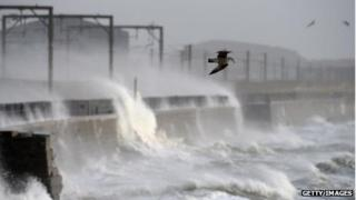 Waves crash over a wall near Saltcoats station on December 24 2013
