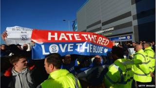Fans protesting with banners outside Cardiff City Stadium