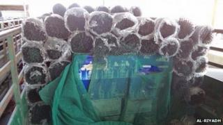 Bales of wire fencing with bottles of wine reportedly in them.