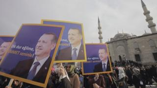 """Supporters of the ruling AK Party hold posters of Turkey""""s Prime Minister Tayyip Erdogan during a demonstration in support him in Istanbul December 27, 2013"""